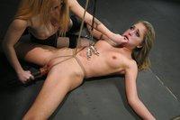 Cute girl in BDSM lesbian sex.