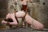 Redhead ass fucked in bondage by lesbian