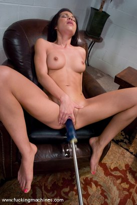 Young tight babe is machine fucked on high, pussy stretched.