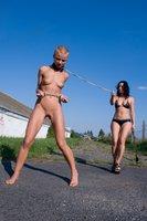 Exotic girl in outdoor BDSM.