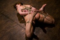 Hot brunette learns to love submission to our ropes