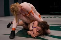 Tiny red head kicks ass then fucks her opponent.  Nude wrestling.