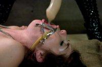 Busty slut in bondage and lesbian domination.