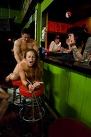 Busty brunette gets fucked in front of a bar full of people