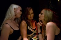 Busty girl dominated by two badass lesbians in night club.