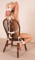 Bound, gagged, masked, and strapped to the bench.