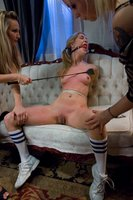 Cute girl in bondage and fucked by Lesbians.