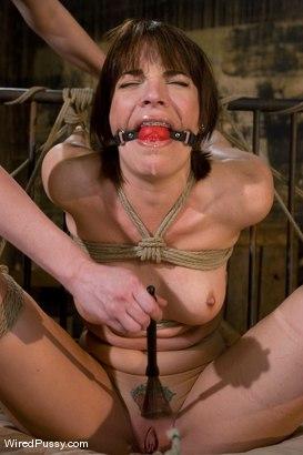 Claire Adams dominates Dana DeArmond in lesbian BDSM scene