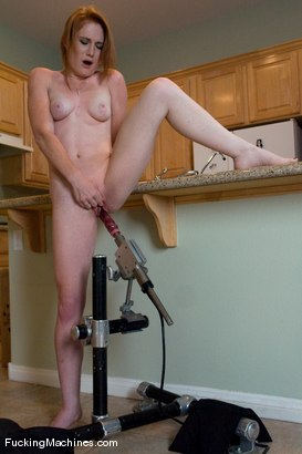 hot red head machine fucked in her own kitchen - cums like mad!