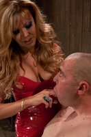 TS Johanna B in a long bright red latex dress is worshiped by her boy toy. He sucks her cock, rims her ass, licks her tits and gets pounded in his as