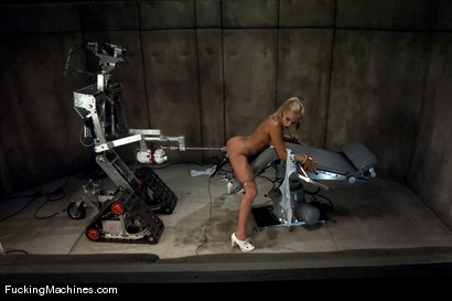 Blond babe fucked by sci-fi machines, cums uncontrollably in bondage from robot fucking, suction and probing in her pussy and ass.