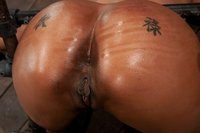 Bound and helpless Kapri Styles's oiled huge ass is up and ready.