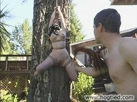 See what happens as Paige Richards gets tied to a tree.