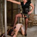 Bad ass dominatrix hobbles dogboy and fucks him in the ass with her fist!
