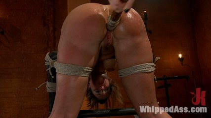 Voluptuous and eager to please, Kelly Devine makes an outstanding debut at Whippedass with Lorelei Lee. She gets plenty of face slapping, big tit punishment and spanking for her full round ass. Kelly really gets into the pain and sexual service, taking the cane and licking Lorelei's ass.