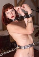 Beautiful Ivy tied, shackled, and flogged.
