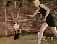 Shade Paine gets some nice whipping and caning from Cowgirl.