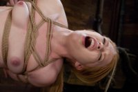 Madison Young comes hard in severe ropes bondage and suspension.