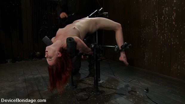 Girl next door is bound in hard metal, bent over backwards and made to cum over and over.