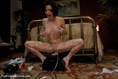 Squirting MILF cums from hard core machine fucking with Fucksall and the Sybian has her  squirting rivers while her tits are sucked by pulsing machine