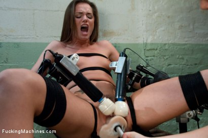 Tori Black tied down and machine fucked with a power tool. She is stuffed full with a thick dong while bound leg spread and open.
