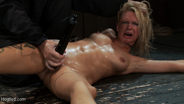 Rain is being made to cum for over 1 hour straight, bound spread on the floor, vibrated, fisted and made to squirt over and over, most brutal!