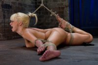 Former-Romanian-Gymnast-puts-her-flexibility-to-the-test-as-she-is-brutally-bound-on-the-floor