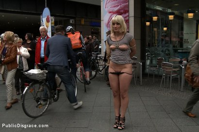 Photo number 4 from Shocked in the Street shot for Public Disgrace on Kink.com. Featuring Steve Holmes, Uma Masome, Zenza Raggi and Princess Donna Dolore in hardcore BDSM & Fetish porn.