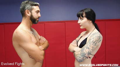 Beautiful Tattooed Goth Babe Takes on Male in CompetitiveWrestling