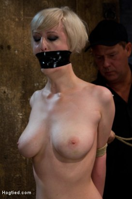 Photo number 3 from Hot Blond with PERFECT BODY, natural tits, severely bound, gagged and abused<br>All on screen tying shot for Hogtied on Kink.com. Featuring Cherry Torn in hardcore BDSM & Fetish porn.