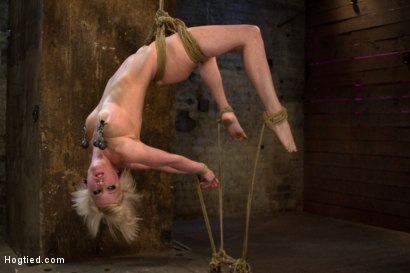 Hot blond suffers though a brutal Category 5 inverted suspension. How many orgasms can she take?