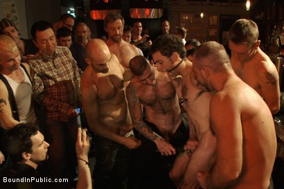 Photo number 5 from Use the stud's uncut cock as a shot glass at a public bar! shot for Bound in Public on Kink.com. Featuring Josh West and DJ in hardcore BDSM & Fetish porn.