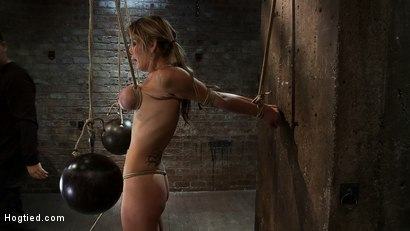 Photo number 11 from Hot Blond has her huge tits punished with bowling balls, pulled to her tip toes<br>Extreme suffering shot for Hogtied on Kink.com. Featuring Felony in hardcore BDSM & Fetish porn.