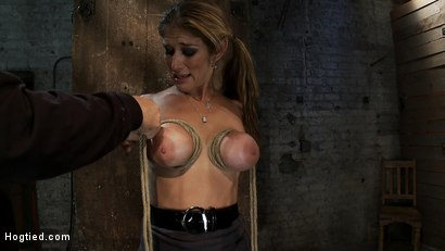 Photo number 4 from Hot Blond has her huge tits punished with bowling balls, pulled to her tip toes<br>Extreme suffering shot for Hogtied on Kink.com. Featuring Felony in hardcore BDSM & Fetish porn.