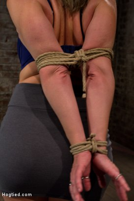 Photo number 3 from MILF with HUGE EE tits gets them severely bound<br>Pulled brutally to tippy toes!<br>Yea that hurts shot for Hogtied on Kink.com. Featuring Sara Jay and Isis Love in hardcore BDSM & Fetish porn.