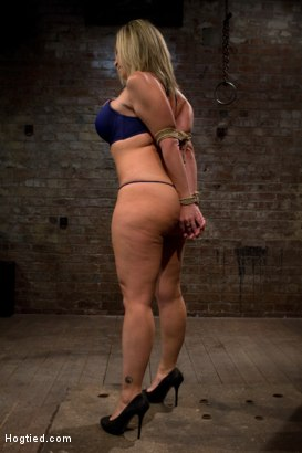 Photo number 4 from MILF with HUGE EE tits gets them severely bound<br>Pulled brutally to tippy toes!<br>Yea that hurts shot for Hogtied on Kink.com. Featuring Sara Jay and Isis Love in hardcore BDSM & Fetish porn.