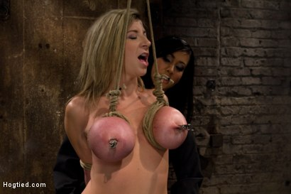 Photo number 6 from MILF with HUGE EE tits gets them severely bound<br>Pulled brutally to tippy toes!<br>Yea that hurts shot for Hogtied on Kink.com. Featuring Sara Jay and Isis Love in hardcore BDSM & Fetish porn.