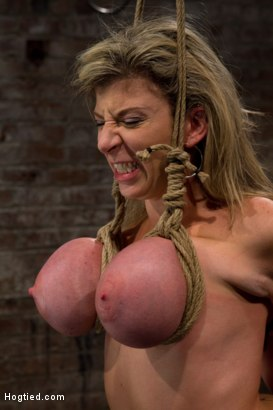 Photo number 8 from MILF with HUGE EE tits gets them severely bound<br>Pulled brutally to tippy toes!<br>Yea that hurts shot for Hogtied on Kink.com. Featuring Sara Jay and Isis Love in hardcore BDSM & Fetish porn.