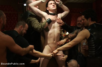 Photo number 3 from Partygoers beat and skull fuck a big dick stud in bondage.  shot for Bound in Public on Kink.com. Featuring Josh West and CJ in hardcore BDSM & Fetish porn.