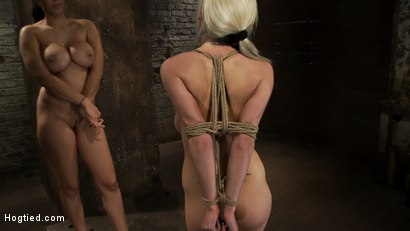 Photo number 15 from ROPE TUTORIAL <br>Part two, we show the wrist tie anchored to a crotch rope. Plus a full arm tie!  shot for Hogtied on Kink.com. Featuring Isis Love and Haley Cummings in hardcore BDSM & Fetish porn.