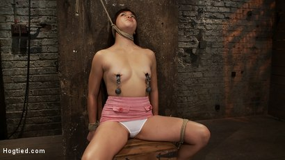 Photo number 5 from 18yr old is bound to the chair<br>Neck rope limits her breathing, this makes her cum hard and often. shot for Hogtied on Kink.com. Featuring Kiki Koi in hardcore BDSM & Fetish porn.