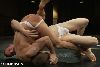 Photo number 4 from Phenix Saint vs Blake Daniels shot for Naked Kombat on Kink.com. Featuring Blake Daniels and Phenix Saint in hardcore BDSM & Fetish porn.