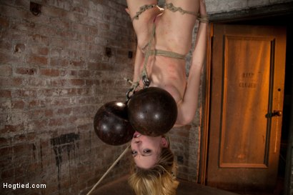 Photo number 12 from March's Live Show 3/3:<br>Zippered, severely flogged, 2 huge bowling balls hung off her pussy. Sexy! shot for Hogtied on Kink.com. Featuring Emma Haize and Isis Love in hardcore BDSM & Fetish porn.