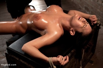 Photo number 7 from Sexy tan oiled blond, is slowly dragged into the darkness by a neck rope<br>Made to cum over & over. shot for Hogtied on Kink.com. Featuring Trina Michaels in hardcore BDSM & Fetish porn.