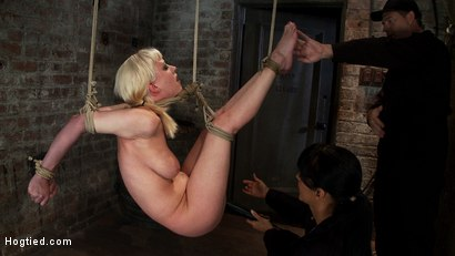 Photo number 13 from April's Live Show 1 of 4<br> Cherry suffers a Category 5 suspension!  All tying done live & on scree shot for Hogtied on Kink.com. Featuring Isis Love and Cherry Torn in hardcore BDSM & Fetish porn.