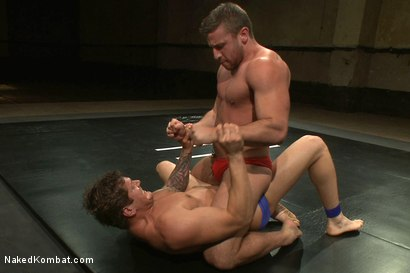 Photo number 2 from Parker London vs Logan Scott shot for Naked Kombat on Kink.com. Featuring Parker London and Logan Scott in hardcore BDSM & Fetish porn.