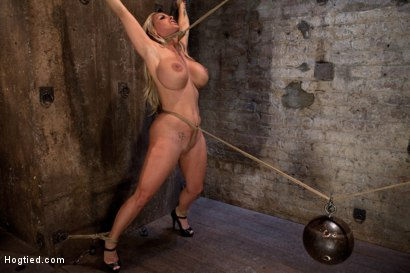 Smoking hot blond MILF with HUGE tits Suffers brutal crotch rope, pulled to the breaking point.