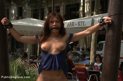 Photo number 6 from Spanish Hottie gets Throat Fucked on the Street<br>Bound in front of a busy cafe! shot for Public Disgrace on Kink.com. Featuring James Deen and Sara May in hardcore BDSM & Fetish porn.