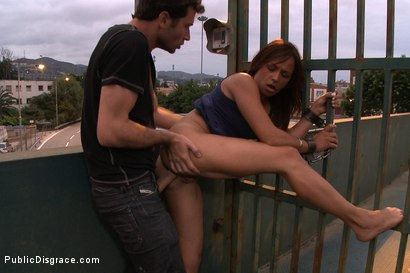 Photo number 12 from Spanish Hottie gets Throat Fucked on the Street<br>Bound in front of a busy cafe! shot for Public Disgrace on Kink.com. Featuring James Deen and Sara May in hardcore BDSM & Fetish porn.