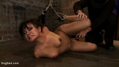 Photo number 10 from Hot Asian bound tightly<br>Gets skull fucked, is fingered & vibrated to multiple squirting orgasms. shot for Hogtied on Kink.com. Featuring Annie Cruz in hardcore BDSM & Fetish porn.